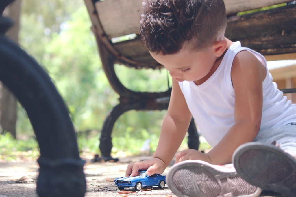 Child_playing_toy_car_Branson_Travel_Group_Tips